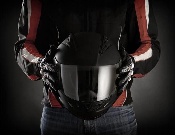 holding motorcycle helmet